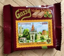 """Ebenfalls aus dem Hause Gossy kommen die """"Marken-Schnitten""""; die jeweils touristische Motive als briefmarkenähnliche """"Marken"""" auf ihrer Vorderseite tragen. Diese sind ablösbar und können gesammelt werden."""